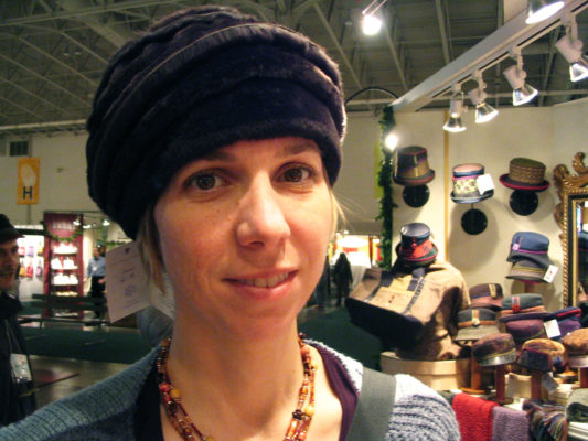 A close up of a woman wearing a Natasha Shearling Hat