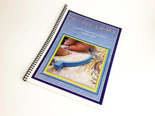 Needlework book on a white background