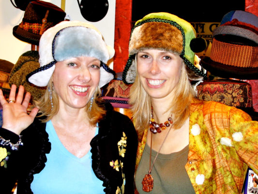 2 women wearing the Pom Pom design hat