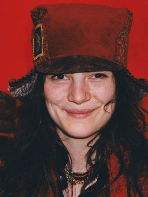 Close up of a woman wearing a Teddy Hat