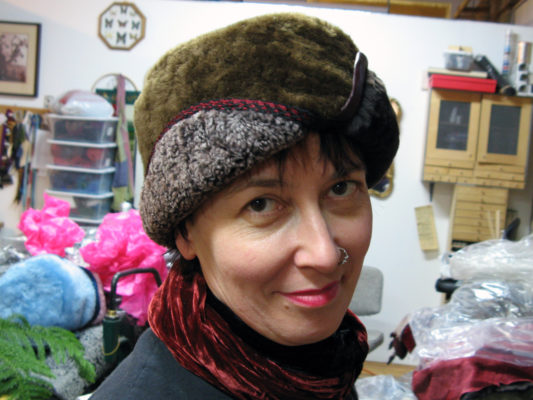 A woman wearing a Snowflake shearling brown hat in the studio