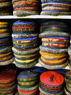 A shelf full of Tibetan Hats