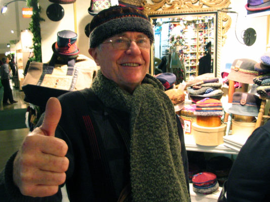 A client wearing his new sage green boucle knit scarf and Tibetan hat