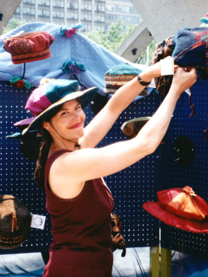 Gwendolyne placing a hat in her display booth at the TOAE