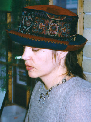 Close up of Gwendolyne wearing a tapestry Uptown rim hat.