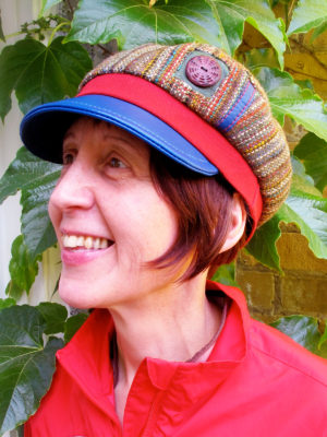 A close up of customer wearing her new royal blue, green and red Abbey Road Cap