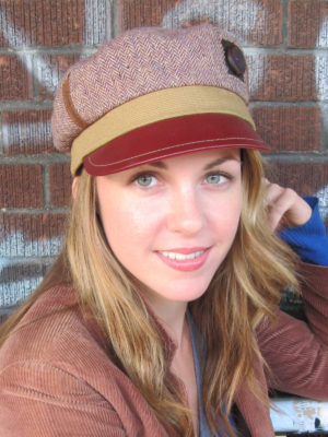 close up of woman wearing a Abbey Road Cap in colors red and gold