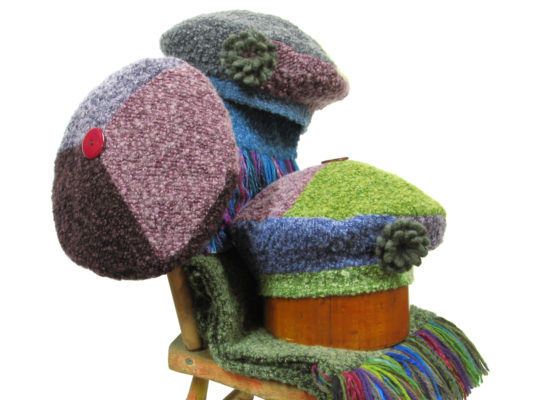 A group of 3 The Ashely Beret Designs on a boucle knit scarf