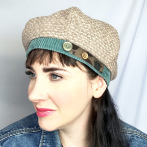 Woman wearing a Beige Bella Beret looking sideways