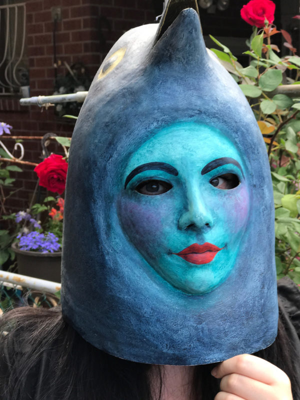 Mask of blue bird on person