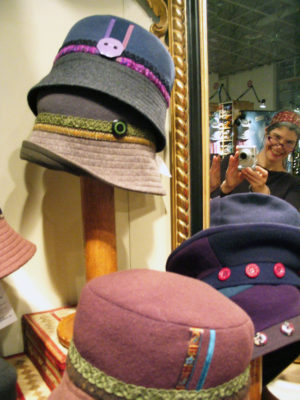 Several Caprice Design hats on display in the shop
