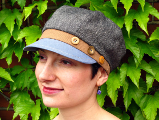 woman wearing a linen Carnaby Cap