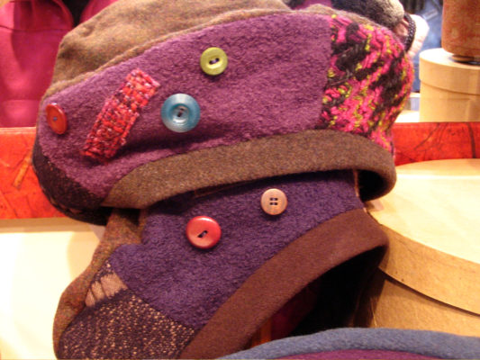 A close up of 2 Celeste Beret on display in the shop