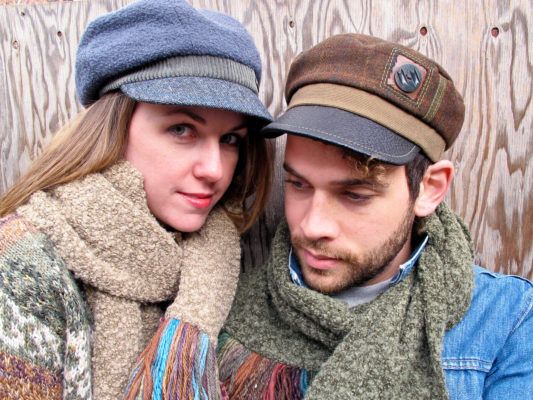 A close up of a man and woman wearing the Donavan and Abbey Road Caps