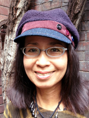 A woman wearing her new dark navy Donavan Cap outside the 401 Richmond building in Toronto