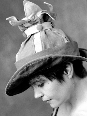 An early black and white photo of Gwendolyne Preboy modelling her linen one off Petal Rim Hat.