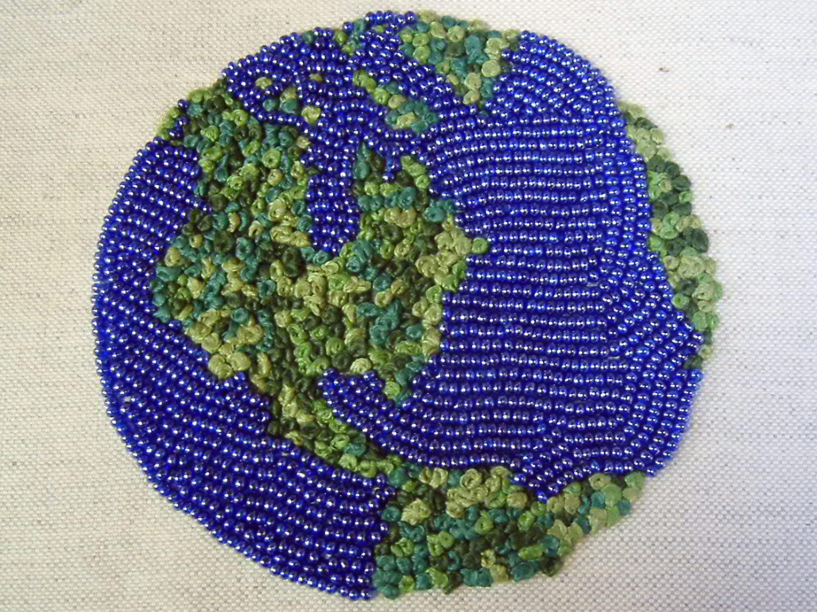 Artwork of the world created in beadwork and french knots