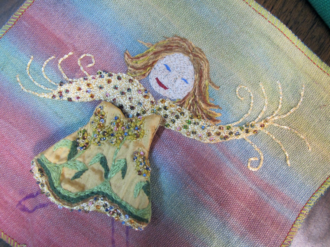 Close up of embroidery artwork of Air Goddess