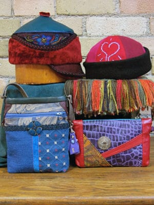 A group of 2 hat and 2 bag designs