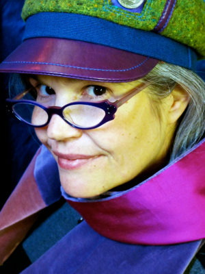 Gwendolyne wearing a Abbey Road wool cap and velvet silk scarf