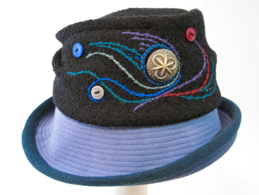 A Harvest Moon hat in black with a light blue upper rim.