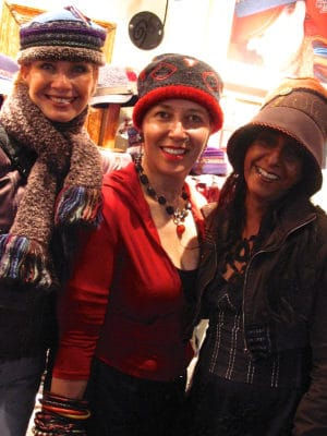 3 women standing wearing Gwendolyne Hats at the one of a kind show in Toronto