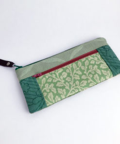 Image showing the front side of this mint green patchwork tapestry wallet