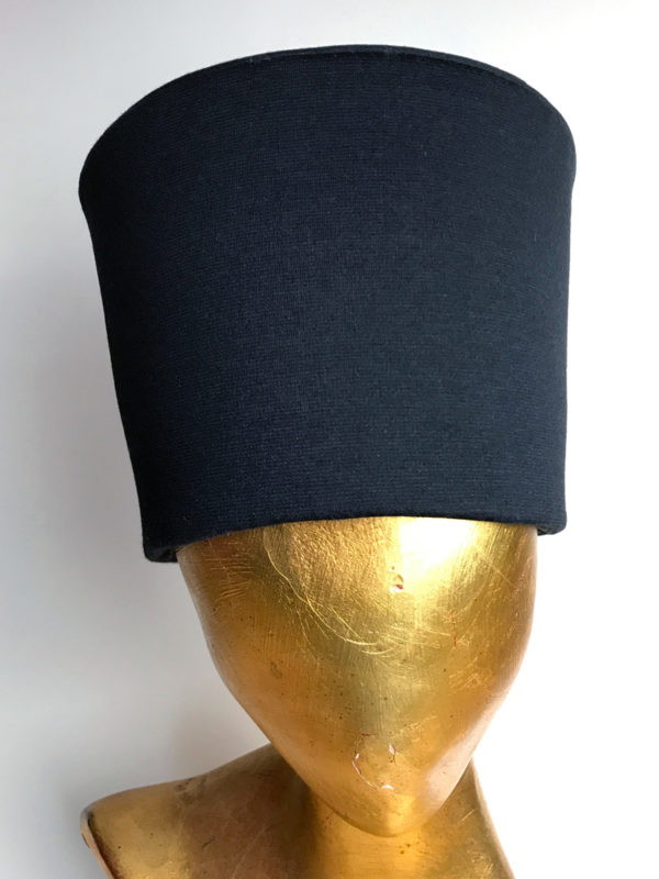 On head stand, one Orthodox priest black headwear