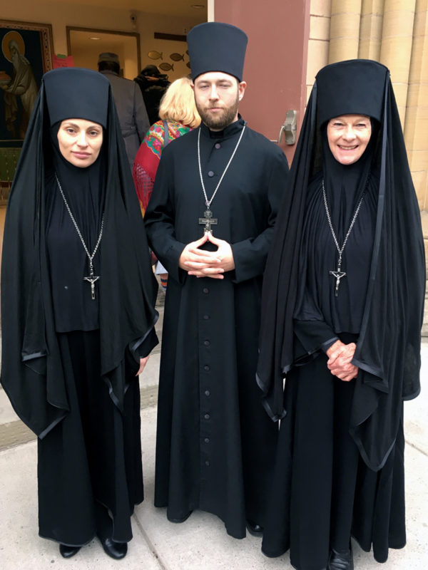 3 actors dressed in garments of Orthodox priests and nuns.