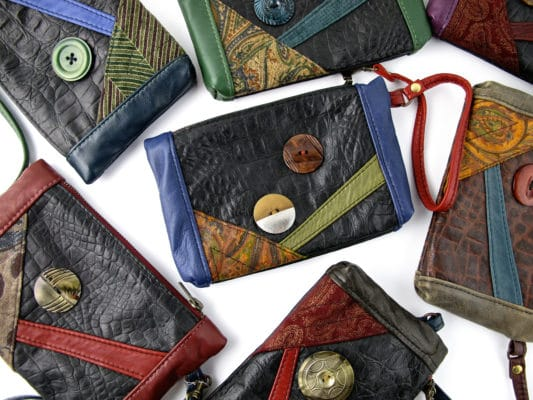A group of leather zippered purses.