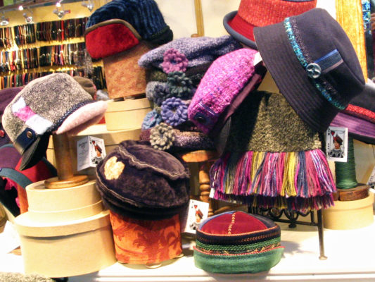 In the shop on display are the Natasha fur hat, the Snowflake, the Ashely Berets, boucle knit scarfs and the Bataar Cap.