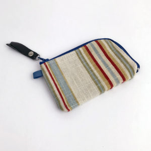 image of a small woman's stripped ivory red green linen zipper card wallet