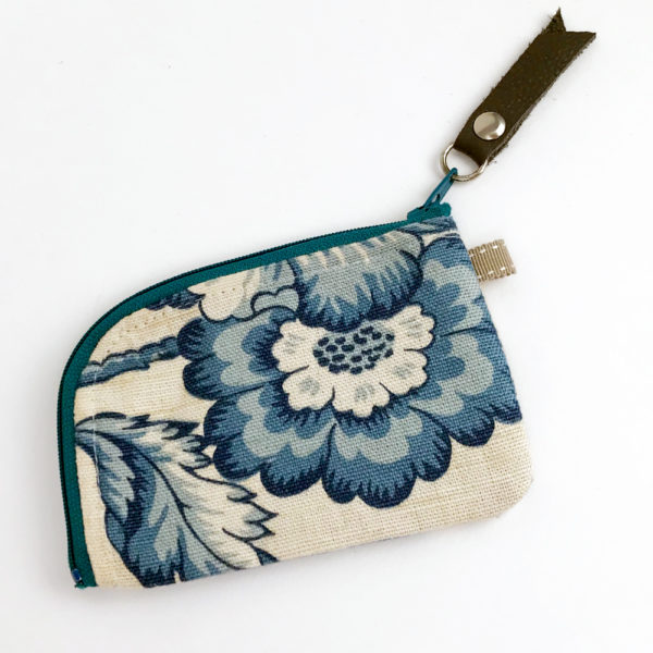 image of a small woman's floral blue toile linen zipper card wallet on its one side