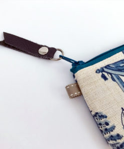 Close up image of the cowhide leather fob on the zipper
