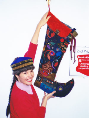 Woman holding up 3' christmas stocking