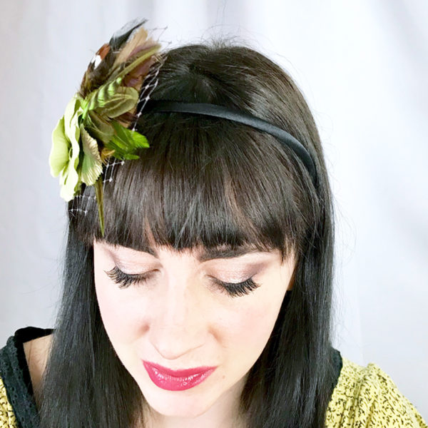 Woman wearing a chartreuse green rose hair clip fascinator in her hair