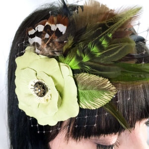 Close up of chartreuse green rose hair clip fascinator in her hair