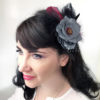 Woman wearing a grey rose hair clip fascinator in her hair