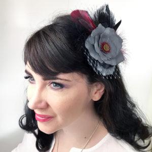 Woman wearing a grey rose hair clip fascinator in her hair