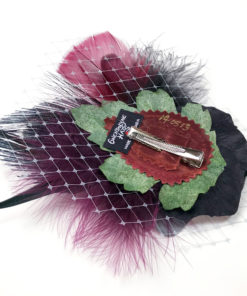 Back side of hair-clip fascinator showing the edition number