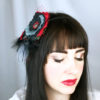 Woman wearing a Red Black Grey rose hair-clip fascinator in her hair