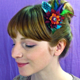 woman wearing flower fascinator in her hair