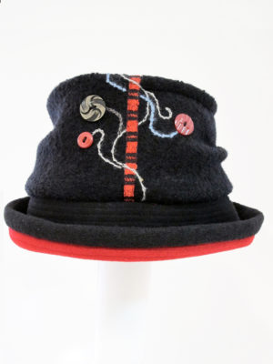 A black and red Harvest Moon Hat with a white background