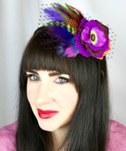 Woman wearing a purple rose hair clip fascinator in her hair