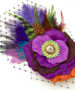 Close up of purple orange lime green rose fascinator hair-clip