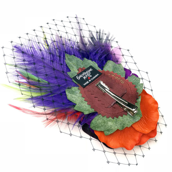 Back side close up of the purple orange lime green rose fascinator