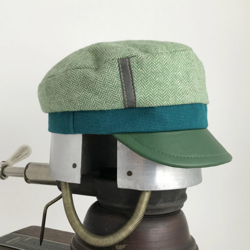 Side view of a mint green Abbey Road cap against a white background