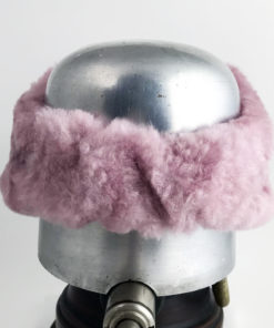 Back view of a pastel pinkAlpine Lamb Shearling Head Band against a white background
