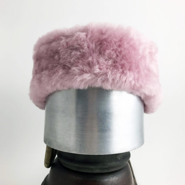 Front view of a pastel pink Alpine Lamb Shearling Head Band against a white background