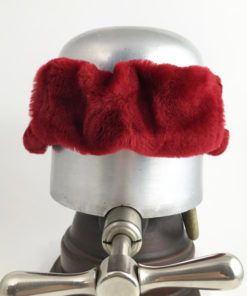 Back view of a Red Alpine Lamb Shearling Head Band against a white background